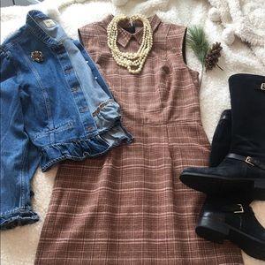 Flannel sleeveless dress. Knee-length.